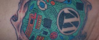 WordPress tattoo on arm