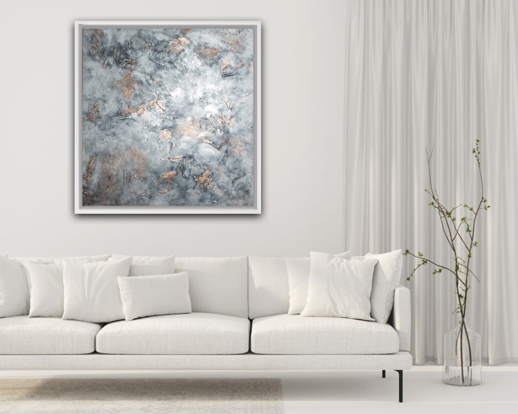 A beautiful painting by Nicole Barbara Arts hangs on the wall of a modern living room